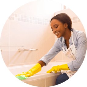 woman smiling while holding a cleaning kit