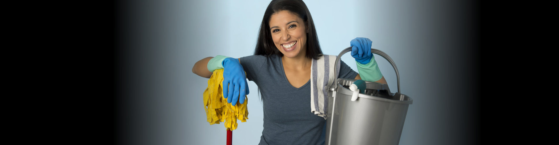 woman holding a cleaning tools